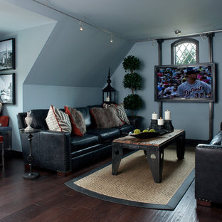 Family room - contemporary dark wood floor and brown floor family room idea in Detroit with gray walls and a wall-mounted tv