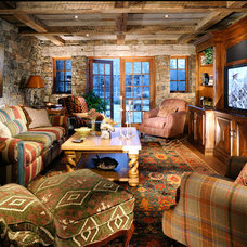 Rustic Home Theater by JLF & Associates, Inc.