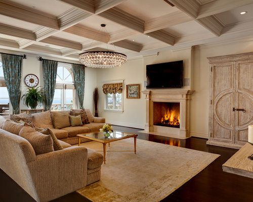 family room lighting design. example of a classic family room design in los angeles with beige walls standard lighting i