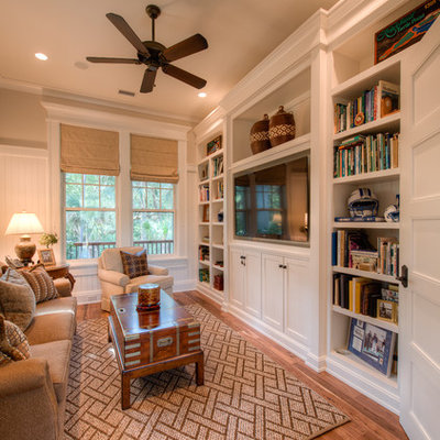 Example of a classic family room design in Charleston