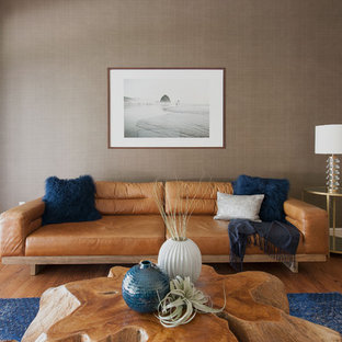 Design ideas for a mid-sized transitional open concept family room in Phoenix with beige walls, no tv, medium hardwood floors and brown floor.