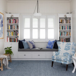 Photo of a mid-sized transitional open concept family room in Brisbane with a library, white walls, no tv, carpet, no fireplace and blue floor.