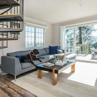Immagine di un soggiorno contemporaneo aperto con pareti beige