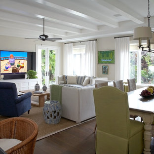 Example of a beach style family room design in Miami