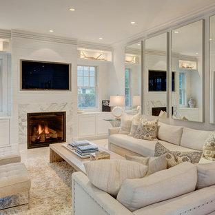 ニューヨークの中くらいのコンテンポラリースタイルのおしゃれなオープンリビング (白い壁、標準型暖炉、埋込式メディアウォール、石材の暖炉まわり) の写真