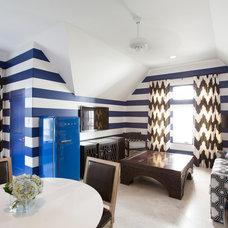 Mediterranean Family Room by Laura U, Inc.