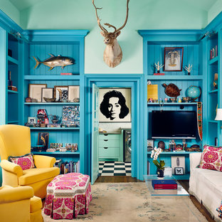Example of an eclectic enclosed dark wood floor family room design in Houston with blue walls and a wall-mounted tv