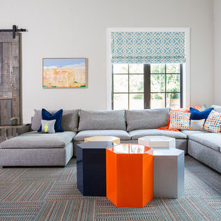 Inspiration for a transitional dark wood floor family room remodel in Houston with gray walls