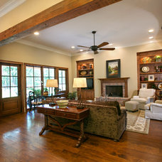 Rustic Family Room by Terry M. Elston, Builder