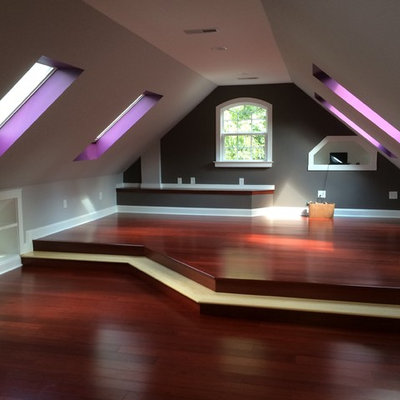 Inspiration for a craftsman loft-style dark wood floor family room remodel in Raleigh with multicolored walls