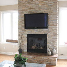Modern Family Room by Realstone Systems