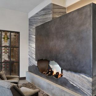 ボイシの中サイズのコンテンポラリースタイルのおしゃれなファミリールーム (ライブラリー、白い壁、セラミックタイルの床、両方向型暖炉、金属の暖炉まわり、テレビなし、グレーの床) の写真