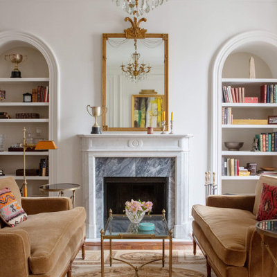 Inspiration for a transitional medium tone wood floor and brown floor family room remodel in Philadelphia with white walls and a standard fireplace