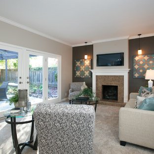 Trendy carpeted family room photo in San Francisco with a standard fireplace, a tile fireplace, a wall-mounted tv and multicolored walls