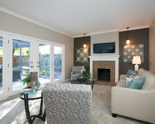 Trendy Carpeted Family Room Photo In San Francisco With A Standard Fireplace Tile