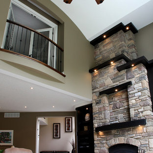 Example of a classic family room design in Toronto with a stone fireplace