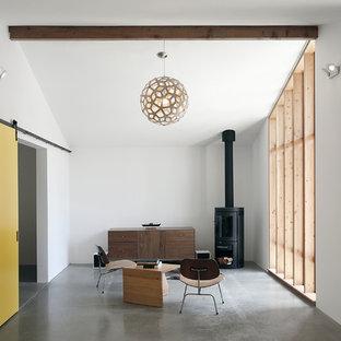 Foto di un piccolo soggiorno minimalista con pavimento in cemento