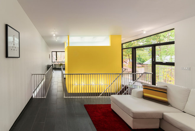 contemporary family room by Kariouk Associates