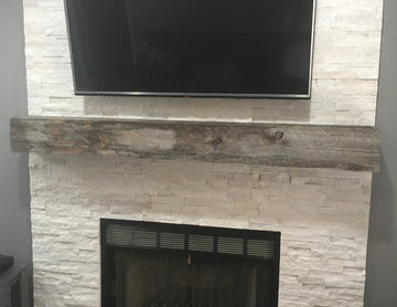 Stacked stone fireplace with reclaimed wood mantle