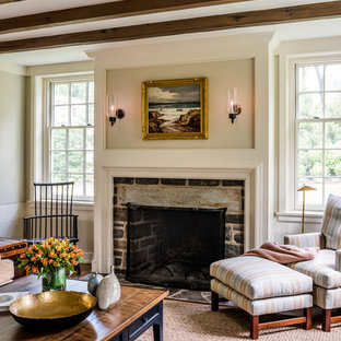 Example of a large farmhouse open concept medium tone wood floor and brown floor family room design in Philadelphia with beige walls, a standard fireplace, a stone fireplace and no tv