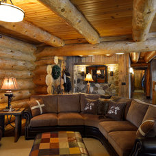Rustic Family Room by Lake Country Builders