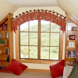 Family room - large eclectic enclosed carpeted and brown floor family room idea in Other with yellow walls