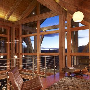Foto di un soggiorno rustico stile loft con pavimento in legno massello medio