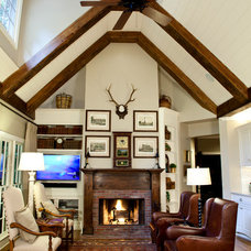 Traditional Family Room by Concepts in Construction
