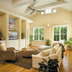 tropical family room by Tongue & Groove
