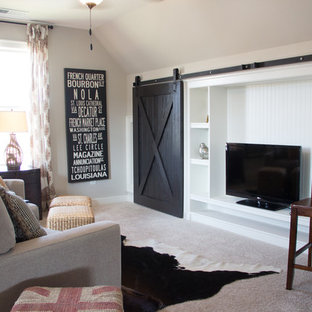Mid-sized farmhouse carpeted family room photo in Birmingham with beige walls, a tv stand and no fireplace