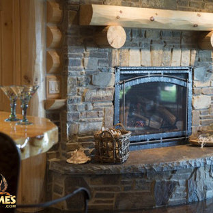 Stone fireplace in a log home model Lakehouse 4166AL by Golden Eagle