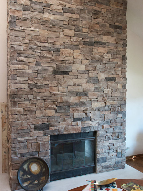 View the dramatic transformation that thin stone veneer can have on your existing fireplace. Your fireplace can be dated brick