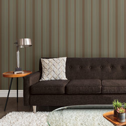 Stripes by Chesapeake - This masculine inspired living room has a midcentury vibe with a cloth brown sofa and adjoining wooden side table. Striped walls in a turquoise and brown pairing look fabulous matched with a white textured rug.