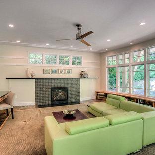 ワシントンD.C.の大きいコンテンポラリースタイルのおしゃれなオープンリビング (ベージュの壁、スレートの床、標準型暖炉、タイルの暖炉まわり、テレビなし、マルチカラーの床) の写真