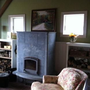 Exemple d'une salle de séjour mansardée ou avec mezzanine chic de taille moyenne avec un mur vert, un sol en bois brun, une cheminée standard, un manteau de cheminée en carrelage et aucun téléviseur.