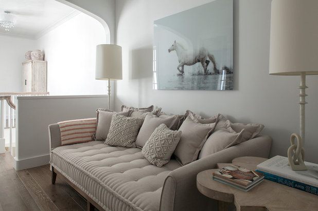 Transitional Family Room by Brad Ramsey Interiors