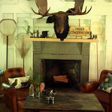 Rustic Family Room by ENJOY Co.