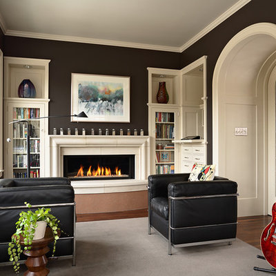 Mid-sized transitional enclosed dark wood floor and brown floor family room photo in Minneapolis with a music area, a standard fireplace, a stone fireplace, no tv and black walls