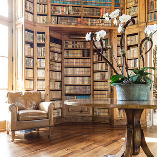 Photo of a mediterranean family room in Dallas with a library.