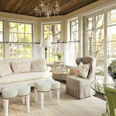 Family room - mid-sized shabby-chic style family room idea in Minneapolis with yellow walls, no fireplace and no tv