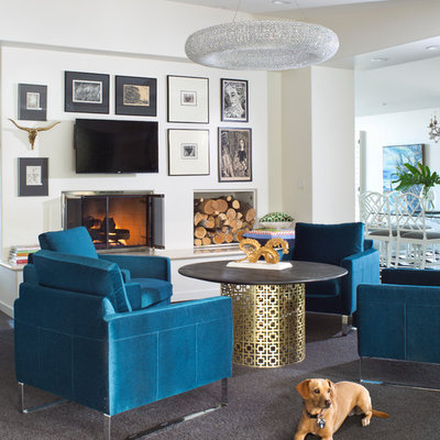 Inspiration for an eclectic open concept family room remodel in Denver with white walls, a standard fireplace and a wall-mounted tv