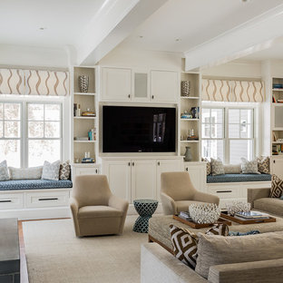This is an example of a large transitional open concept family room in Boston with a library, a built-in media wall, beige walls, light hardwood floors, no fireplace and beige floor.