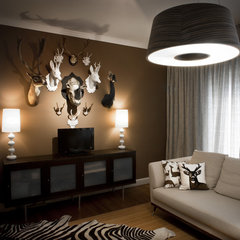 contemporary family room by Supon Phornirunlit / Naked Decor