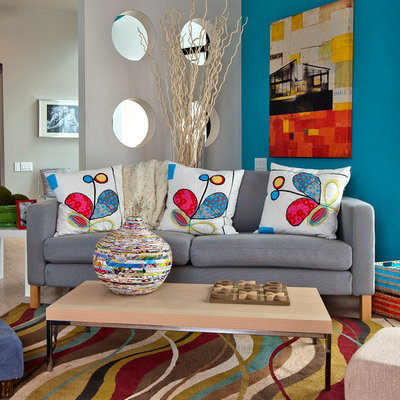 Example of a trendy light wood floor family room design in Austin with multicolored walls