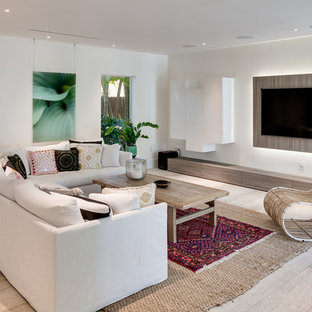 Trendy light wood floor and beige floor family room photo in Miami with white walls and a wall-mounted tv