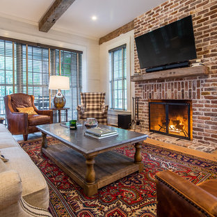 This is an example of a farmhouse family and games room in Atlanta.
