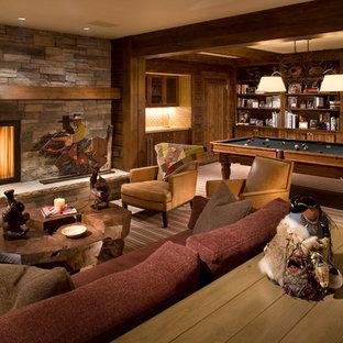 Ispirazione per un soggiorno minimal aperto e di medie dimensioni con sala giochi, moquette, camino classico, cornice del camino in pietra, pareti multicolore e nessuna TV