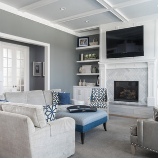 Family room - transitional family room idea in Grand Rapids with gray walls, a standard fireplace, a tile fireplace and a wall-mounted tv