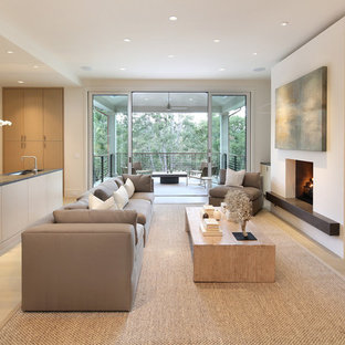 Large minimalist open concept light wood floor family room photo in San Francisco with a bar, a standard fireplace, a wall-mounted tv and white walls