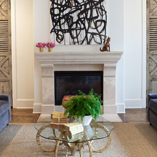 Transitional medium tone wood floor family room photo in Houston with white walls